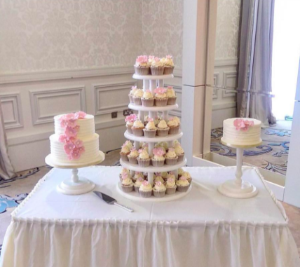 Wedding Cakes alongside Wedding Cupcakes